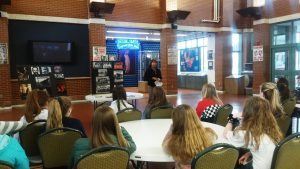 Image of Rita Hubbard speaking to a group of middle school girls